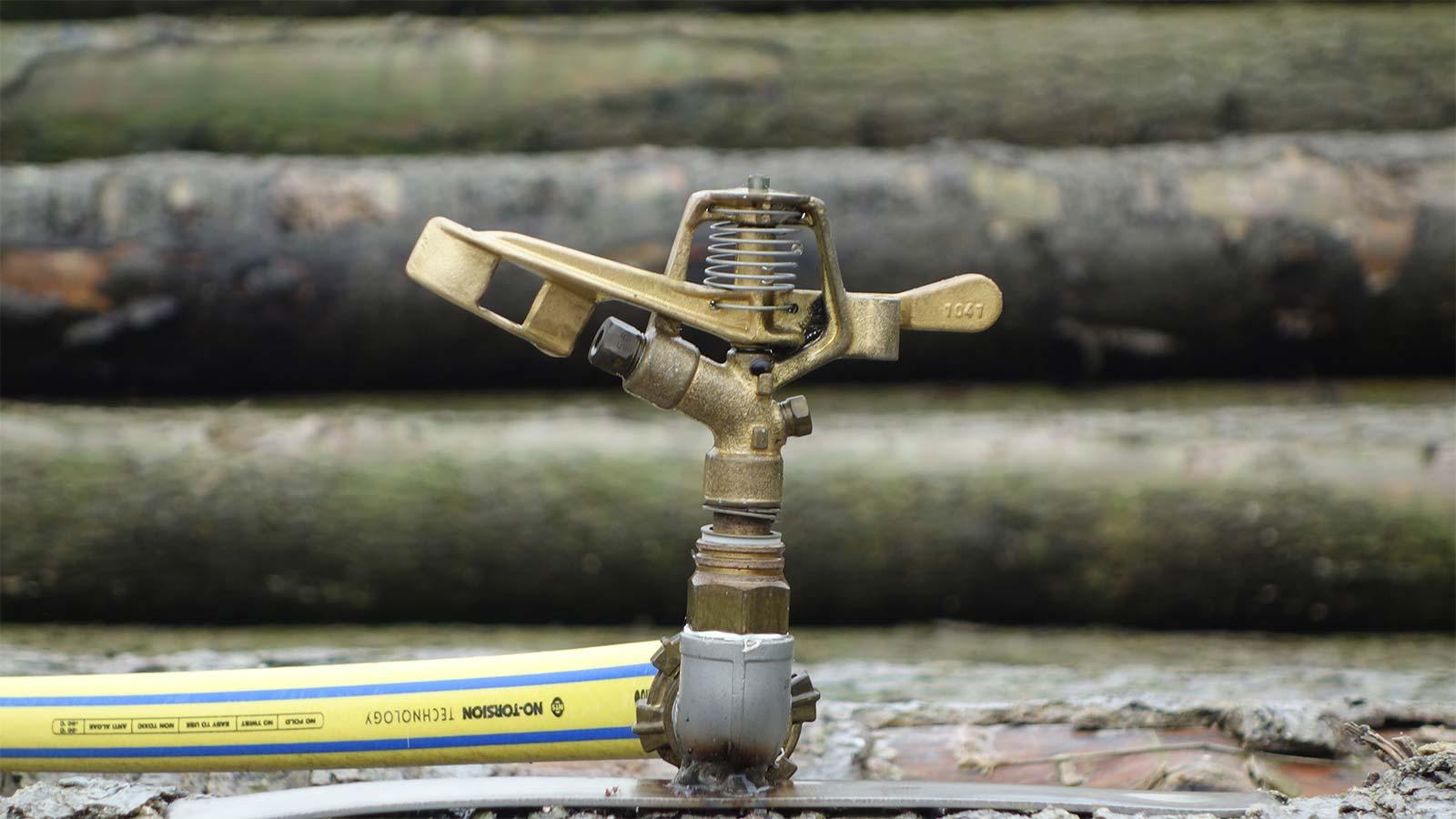 Bewässerung Holz Sprinkler